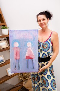 Holding a painting sold at the recent exhibition
